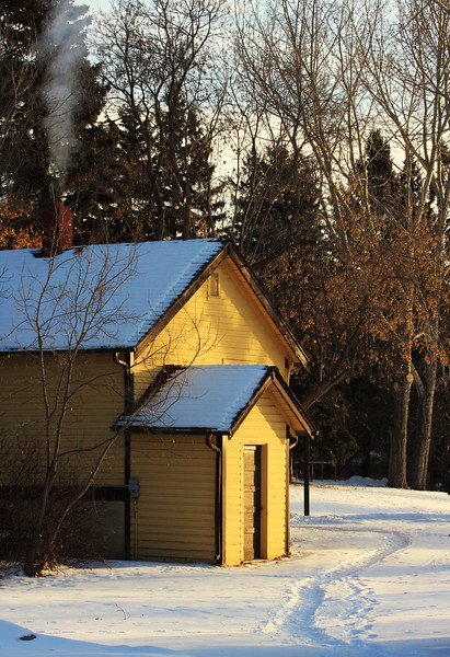 -24 Celsius - I had been playing hide and seek with a large white-tailed buck who was eluding me mostly when I spotted this old house on the historic Bow Valley Ranch located within Fish Creek Provincial Park. I set up to shoot the image and had to wait some time in the cold untill the furnace kicked in giving me the plume of smoke from the chimney that I needed to complete this photo.