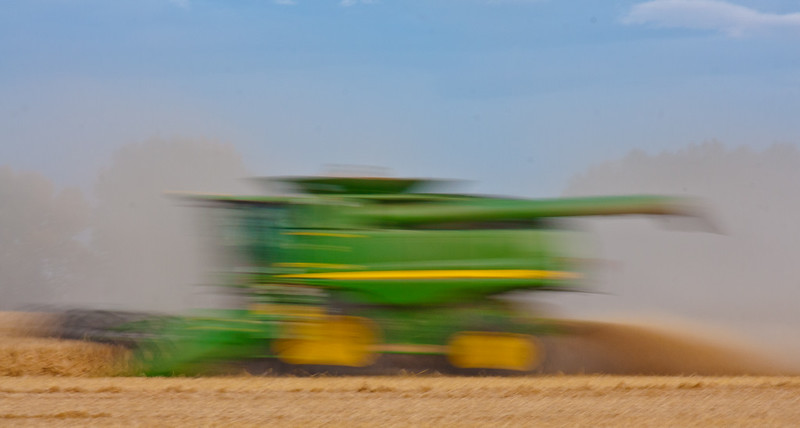 As this combine worked its way past my position in the field, I am having a bit of fun, using a slow shutter speed to speed things up!