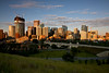 Calgary - The core of the city just after sunrise -  Of course, it goes without saying that building cranes are part of Calgary's pedigree! Constuction has been on-going since Calgary's beginnings in 1875, when the NWMP (North West Mounted Police) built their fort at the confluence of the Bow and Elbow Rivers just a few blocks to the east in this photo. The building on the left with the top decorated with building cranes is THE BOW, a most unusual building, as it is being constructed with steel instead of concrete.  Once completed it will be the tallest building in western Canada. Today there are 1,000,000 + Calgarians, and the growth of the city continues to march relentlessly forward.