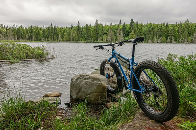 "BIKING 01372  ""Taking a break at Speckled Trout Lake""  Grand Portage, MN"