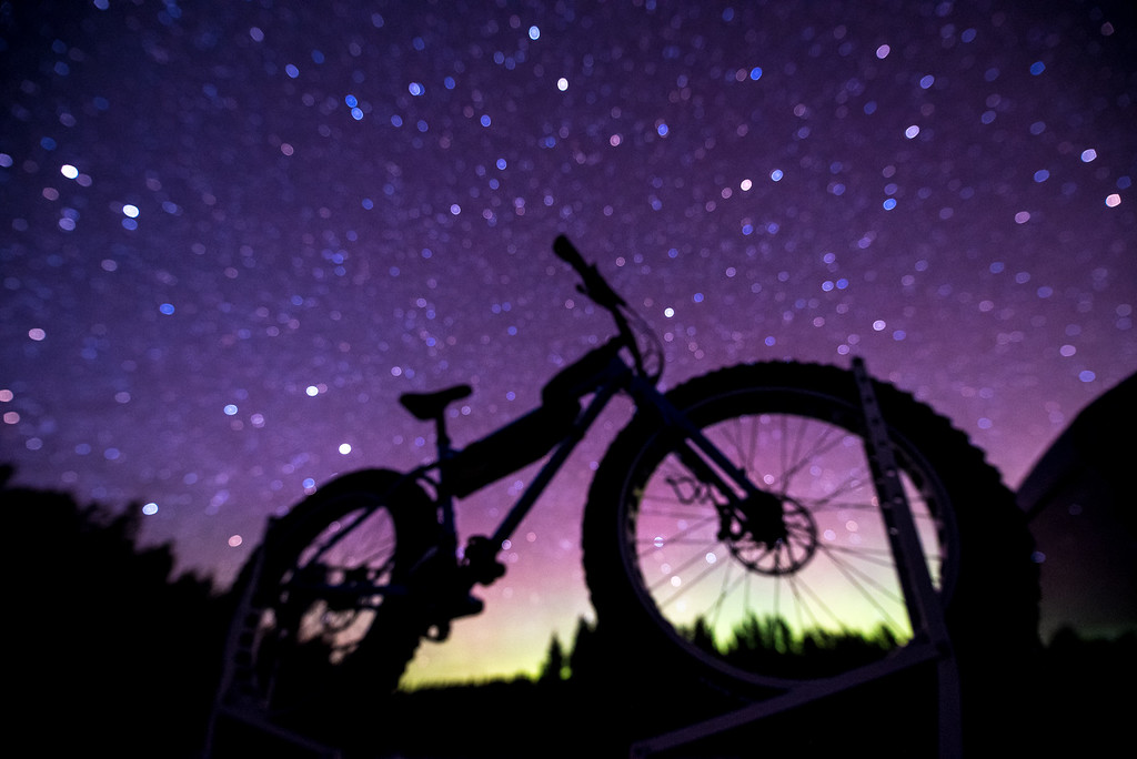 "BIKING 6911<br /> <br /> ""Night Sky Bike""<br /> <br /> A slight glow of northern lights complements the light from the stars on March 7, 2016.  I intentionally shot this photo out of focus to make the stars appear large in the sky."