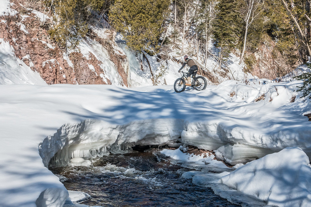 BIKING 08823<br /> <br /> Some of the openings in the ice made for some pretty dramatic photos! <br /> <br /> Devil Track River just north of Grand Marais, MN