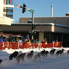 Credit: Jade Frank/FCVB<br /> <br /> A musher and dog team race down Second Avenue in downtown Fairbanks during the Open North American Championship Sled Dog Race.