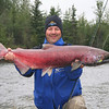 Credit: FCVB<br /> <br /> A visitor poses with his catch—a King salmon from the Chena River near Fairbanks, Alaska.