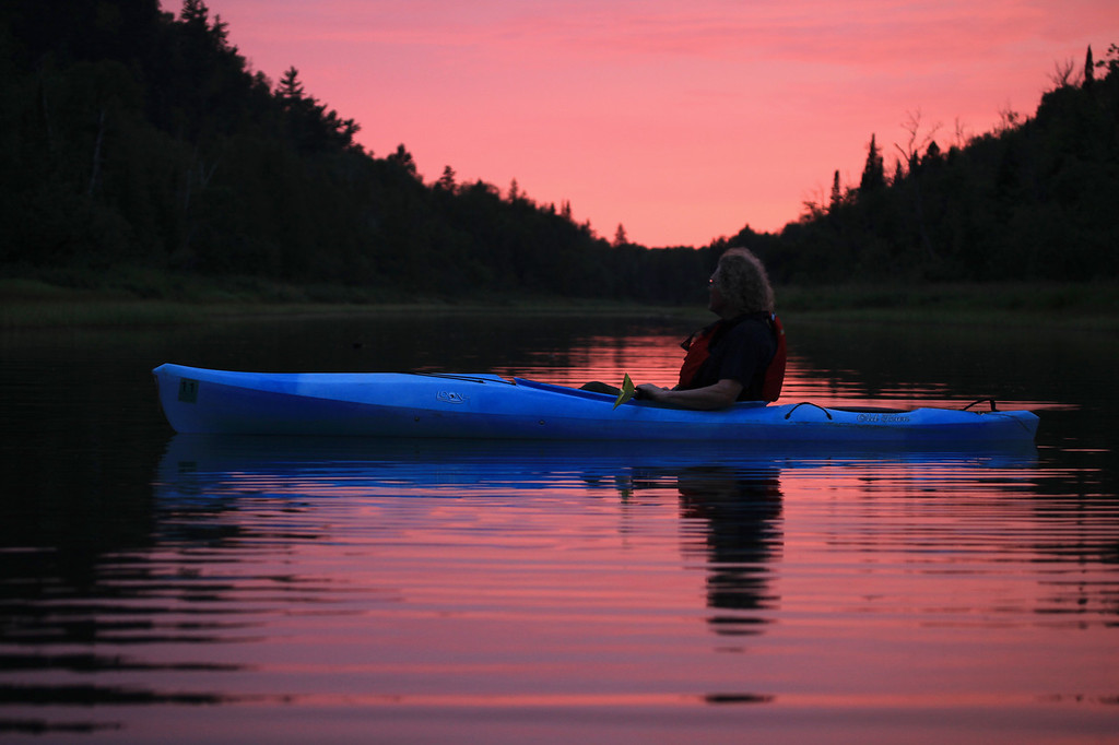 "KAYAKING 9035<br /> <br /> ""Front Row Seat, Pigeon River Sunset""<br /> <br /> Grand Portage, MN"