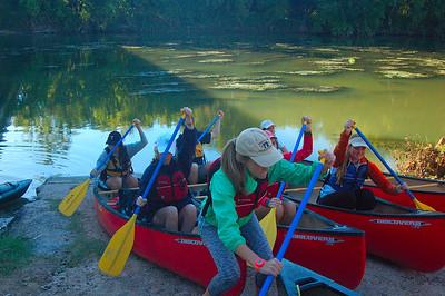Longhorn Stream Team volunteers learn proper paddling and steering canoeing strokes.