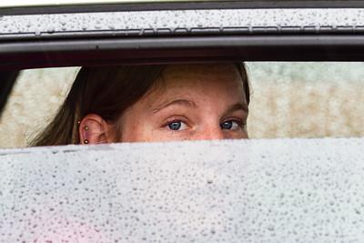 Jessie through rainy car window