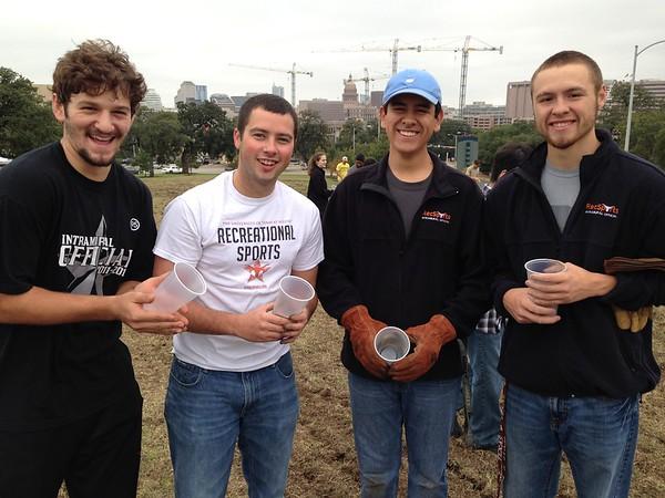 Brandon Caporale, Chad Zimmerman, Angel Arreola, Joseph Chavez help spread Bluebonnet seed on the UT-Austin Campus