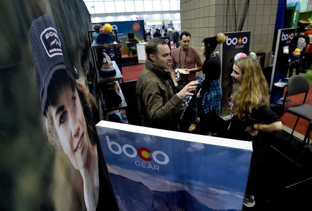 . DENVER, CO - JANUARY 30, 2019: BOCO Gear employee Laura Knoblach talks with Beau Harrison, with Human Design LLC, during the Outdoor Retailer and Snow Show on Wednesday in Denver. For more photos of Boulder County companies participating in the show go to dailycamera.com (Photo by Jeremy Papasso/Staff Photographer)