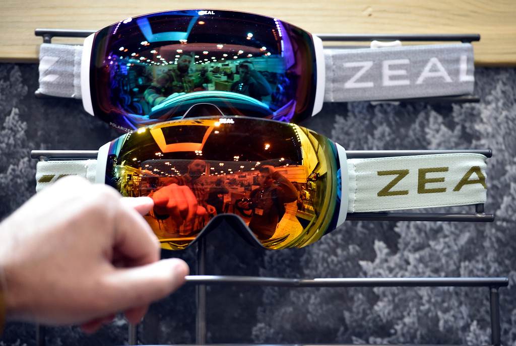 . DENVER, CO - JANUARY 30, 2019: Zeal Optics employee Austin Smith, left,  and David Dieter, with IRev Apparel, are reflected in a pair of goggles during the Outdoor Retailer and Snow Show on Wednesday in Denver. For more photos of Boulder County companies participating in the show go to dailycamera.com (Photo by Jeremy Papasso/Staff Photographer)