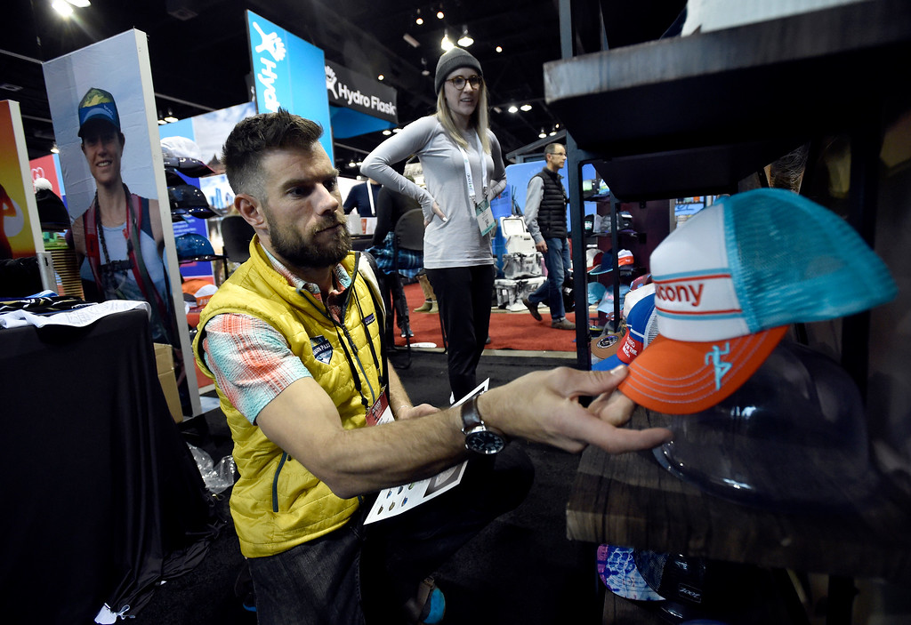 . DENVER, CO - JANUARY 30, 2019: Brian Smuda, with Season Pass Sales, talks with BOCO Gear employee Jessie Smith during the Outdoor Retailer and Snow Show on Wednesday in Denver. For more photos of Boulder County companies participating in the show go to dailycamera.com (Photo by Jeremy Papasso/Staff Photographer)