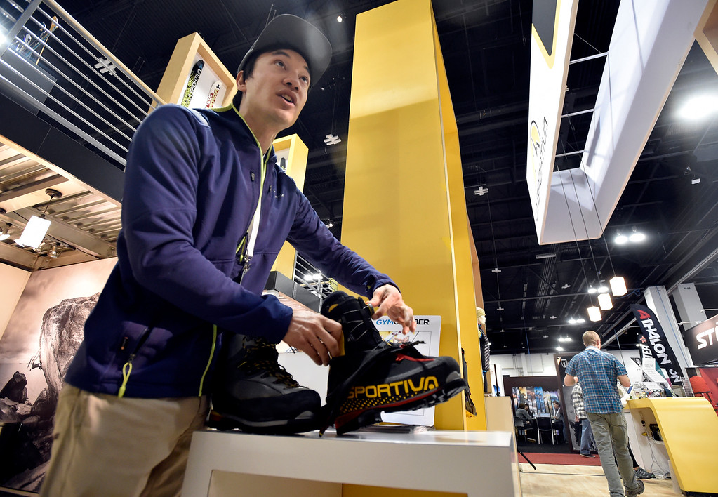 . DENVER, CO - JANUARY 30, 2019: La Sportiva employee Jake Burgart shows a pair of boots to a consumer during the Outdoor Retailer and Snow Show on Wednesday in Denver. For more photos of Boulder County companies participating in the show go to dailycamera.com (Photo by Jeremy Papasso/Staff Photographer)
