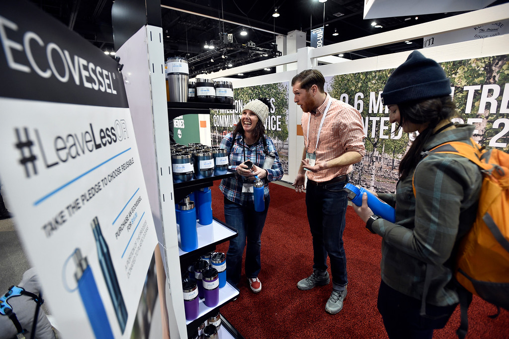 . DENVER, CO - JANUARY 30, 2019: Abigail Slingsby, left, laughs while talking with Boulder-based EcoVessel employee Nate Etter during the Outdoor Retailer and Snow Show on Wednesday in Denver. For more photos of Boulder County companies participating in the show go to dailycamera.com. (Photo by Jeremy Papasso/Staff Photographer)