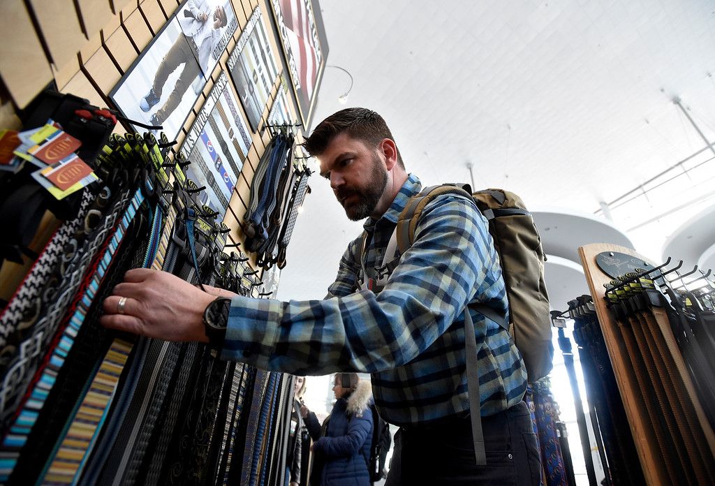 . DENVER, CO - JANUARY 30, 2019: Andrew Martin, with Vectra Bank, looks at belts made by Longmont-based Bison Designs during the Outdoor Retailer and Snow Show on Wednesday in Denver. For more photos of Boulder County companies participating in the show go to dailycamera.com (Photo by Jeremy Papasso/Staff Photographer)