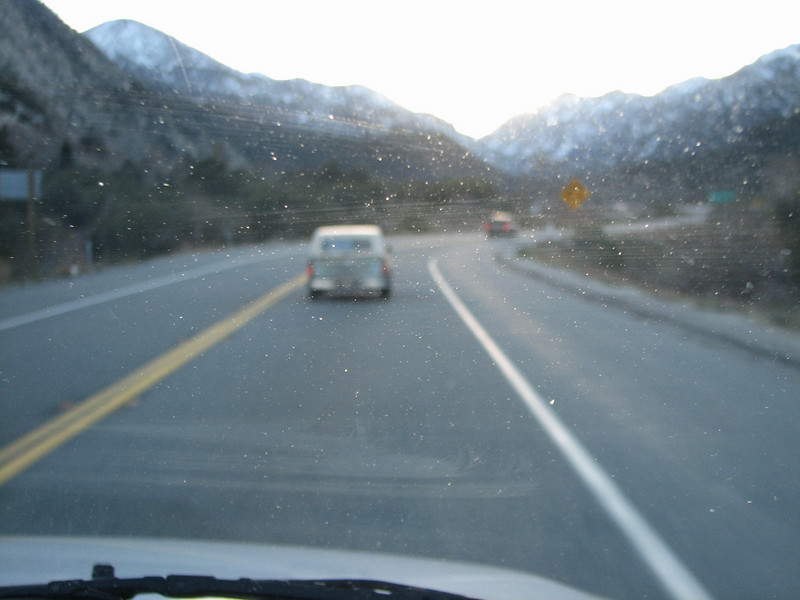 Driving up Hwy 38 from the Redlands area. Oops, got the windshield in focus instead of the mountains!