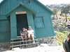 John and me at the Ski Hut. Camera is crooked because I had to place it on a rock. You can just see the outhouse around the right side. My dang hat got a twist in the bill, and for the life of me I can't fix it!