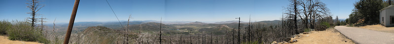 This is a panoramic shot I took from the back (east) side of the mountain, just 100 feet from the summit. In the center of the shot, in the far distance, is the Imperial Valley and the Salton Sea.