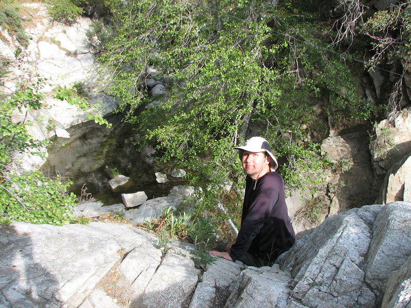 Here I am above the falls. From where I'm sitting, it's a short step to a big drop. Good thing I wasn't feeling dizzy!