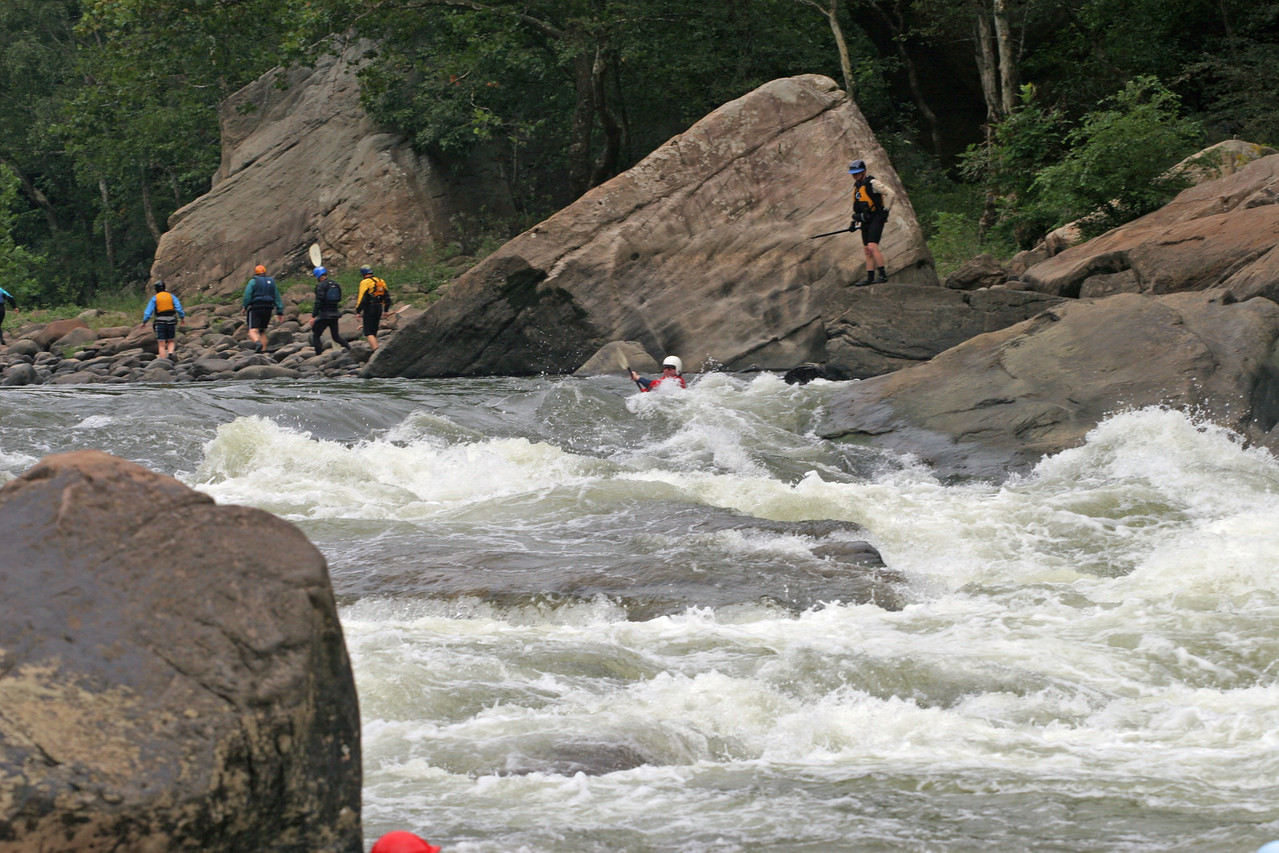 "This is a short series of Cahil Converse running Lower Keeney at about 6"" in 2006. Cahill was in a brand new boat, a Fluid Spice L.<br /> <br /> <br /> The point I'd like to make using this series is the importance of bracing. Cahill is extremely comfortable in this rapid at this level. His casual effort belies his intentions. He starts out on the extreme left, why? Because he can and he knows that he'll feed down to the bottom of the tongue and eventually to the awaiting reactionary wave, no matter how he starts.<br /> <br /> Suggestion: Click on the Slideshow button on the upper right. Click in the caption and fade boxes, set duration for 10 seconds, click on full screen, sit back. :)"