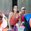 The first day of free outdoor yoga started Saturday at 9:30 AM at the new Mill Street stage, July 27, 2019. Instructor Cera Hawkins of Good Karma Yoga Therapy in Fitchburg leads the class. Following along during the class is Alex Mallard of Fitchburg, in glasses.  SENTINEL & ENTERPRISE/JOHN LOVE
