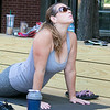 The first day of free outdoor yoga started Saturday at 9:30 AM at the new Mill Street stage, July 27, 2019. Instructor Cera Hawkins of Good Karma Yoga Therapy in Fitchburg leads the class. Following along during the class is Tara Rivera of Fitchburg, in glasses.  SENTINEL & ENTERPRISE/JOHN LOVE