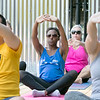 The first day of free outdoor yoga started Saturday at 9:30 AM at the new Mill Street stage, July 27, 2019. Instructor Cera Hawkins of Good Karma Yoga Therapy in Fitchburg leads the class. Following along during the class is Emmanuella Janita of Fitchburg, in blue.  SENTINEL & ENTERPRISE/JOHN LOVE