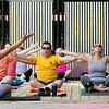The first day of free outdoor yoga started Saturday at 9:30 AM at the new Mill Street stage, July 27, 2019. Instructor Cera Hawkins of Good Karma Yoga Therapy in Fitchburg leads the class. In the front row following along is, from left, Josiah Richards, Joe Bowen and Tara Rivera all of Fitchburg. SENTINEL & ENTERPRISE/JOHN LOVE