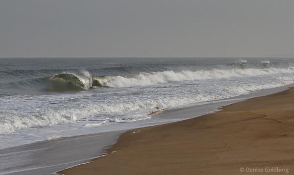 waves curling, crashing
