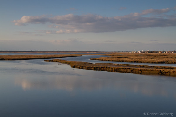 reflections in smooth water, from the bridge to Plum Island in Newburyport, MA