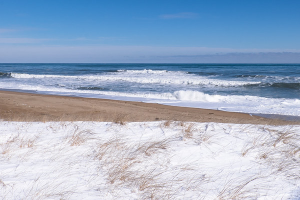 snow, sand, and ocean waves