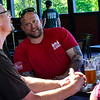 KRISTOPHER RADDER — BRATTLEBORO REFORMER<br /> Pete Johnson talks with Mike Pfeil while enjoying a drink at the Whetstone's Bier Garten, in Brattleboro, Vt., as restaurants in Vermont were allowed to open up their outdoor seating area on Friday, May 22, 2020.