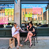 KRISTOPHER RADDER — BRATTLEBORO REFORMER<br /> Loretta Vinson, of Brattleboro, Vt., and Michelle Ielpi, of Saxtons River, Vt., enjoy a drink while sitting at a table outside the Tulip Cafe, on Main Street, Brattleboro, on Friday, May 22, 2020. Restaurants in Vermont were allowed to open up their outdoor seating area.