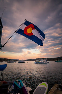 A Colorado flag flies from a houseboat in the marina near the dam at Navajo Lake State Park in New Mexico.