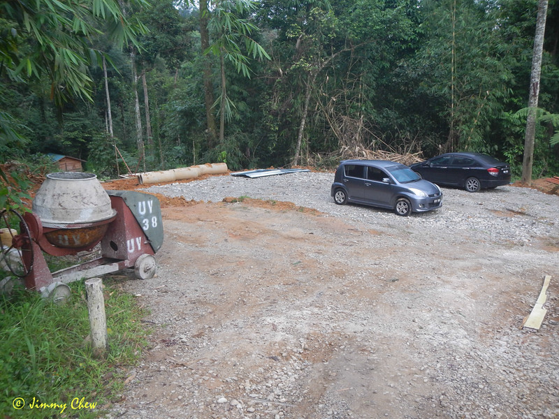 The car park before the Father's Organic Farm signboard. It is being expanded. Most cars are to park here. This is the official car park.
