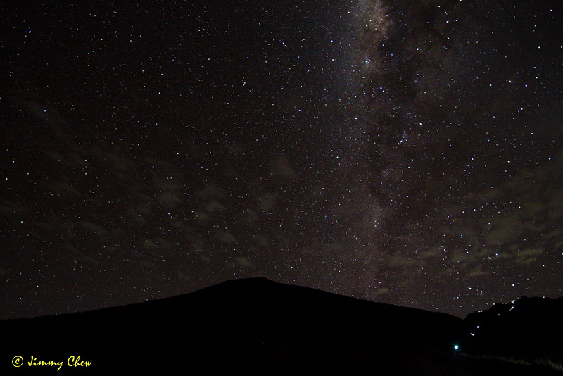 Part of the Milky Way as seen from Pos 2 campsite with Mount Rinjani as the backdrop. Those on the foreground aren't stars - they are from the hikers' headlamp - night hike.