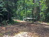 First sight of campsite. Those structures believed to be Teratak's.