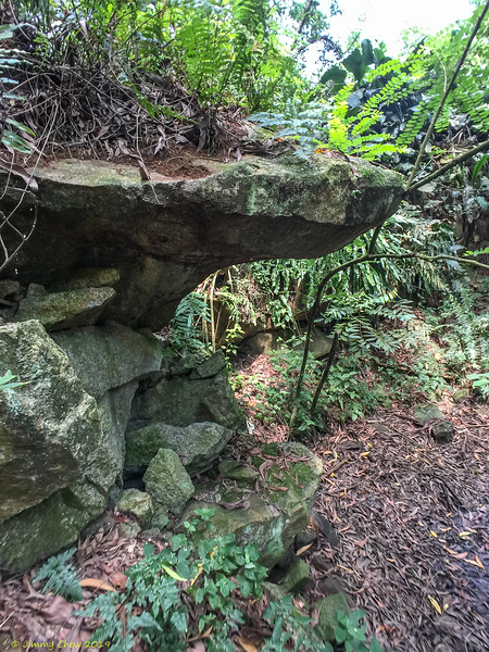 Overhanging rock - great as temporary shelter during rain - fits two (standing)!