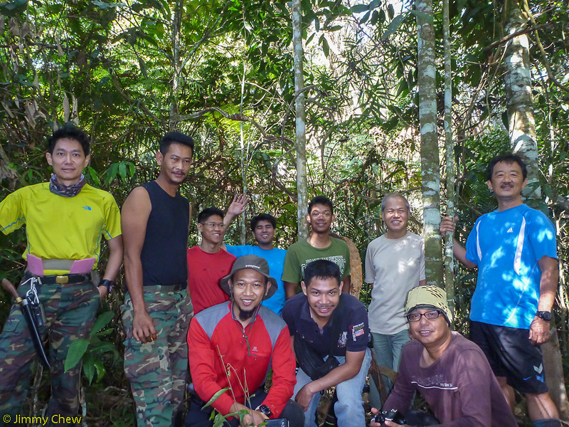Group photo with the collapsed trig station. — with Triston Teow, Encik Bear, Fahmirulah Samsukamal, Fairol Ferol, Loi Tc, Anuar Bin Zakaria and Tan Keng Heng.