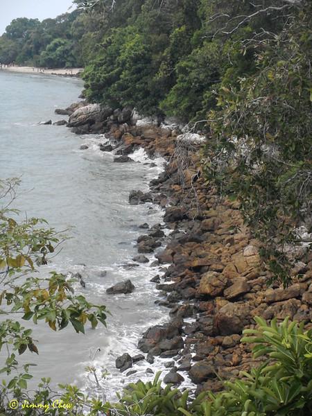 The rocky beach towards Pulau Intan.