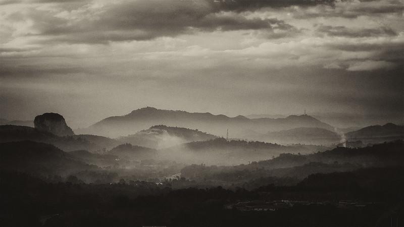 Gua Cinta Manis on the leftside limestone hill.