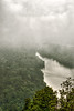 Closer view of the dam below. Mists enveloping the area.