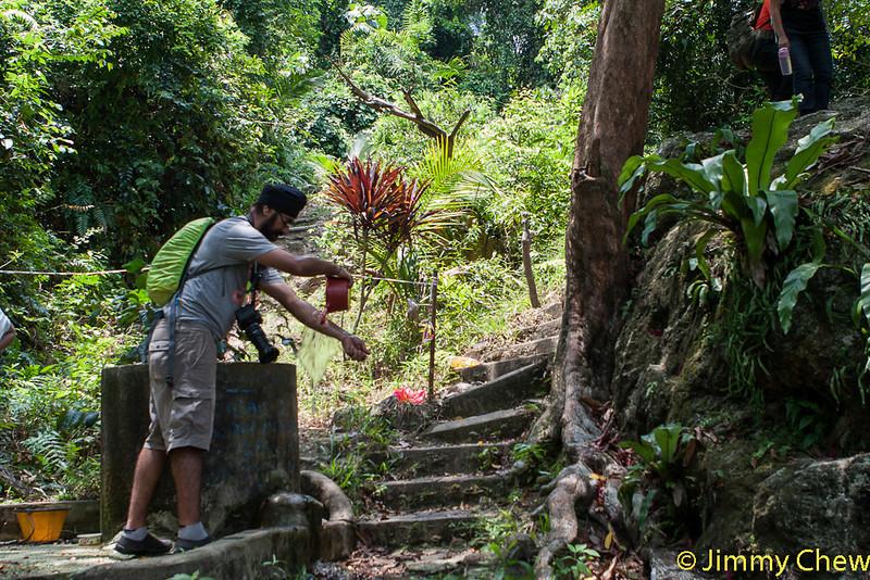 Trip washing arms using water from Perigi Rubiah.