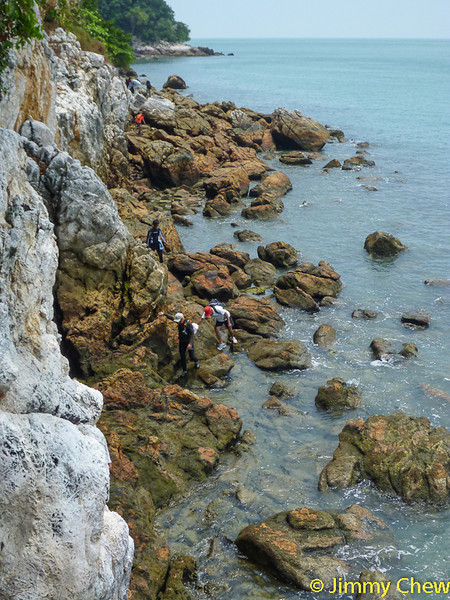 Along the high cliff during low tide. It is not possible to traverse this area during high tide.