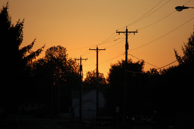 I took this picture from my driveway in Salem, Oregon. I just could not resist the sunset behind the trees and the color of the sky.