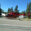 Med Evac helicopter lands in lane next to us.