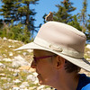 Hiking in the Canadian Rockies. Kay with hitch hiking butterfly.