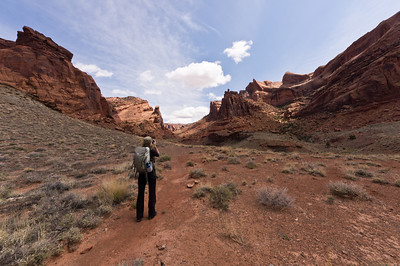 Lynn shooting toward the Crater Spur Trail into Upheaval Dome.