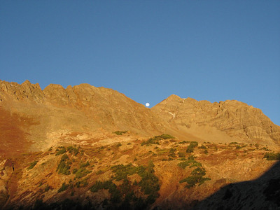 Now, from the correct side of the pass, we proceeded to the summit, with the moon peaking over a ridge.