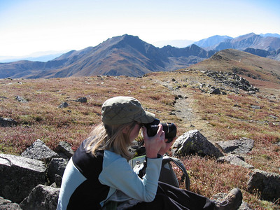 Lynn snapping some photos of Elkhead Pass, with Harvard watching over her.