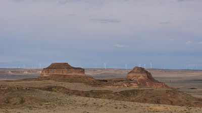 The two buttes really seem to come out of nowhere in the prairie. The windfarms are a more recent addition to the landscape.